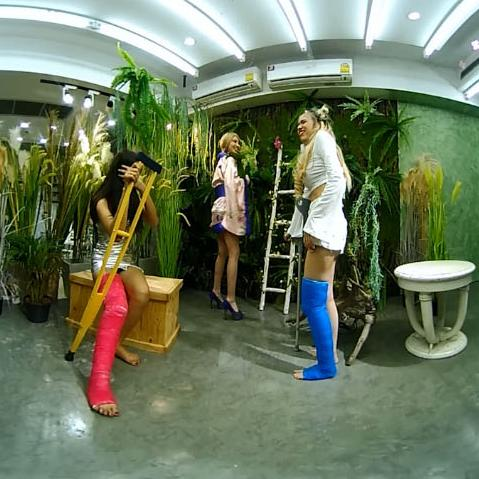 Two hotties with long cast legs in a flower shop